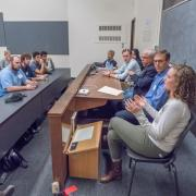 A panel of alumni speaking in a classroom.