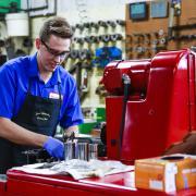 Nicholaus Wolfrum working in a machine shop.