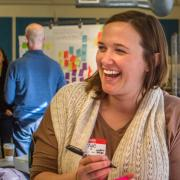Carlye Lauff laughs during a design workshop in the Idea Forge.