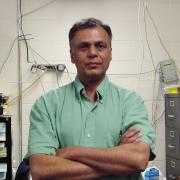 Rishi Raj standing in a lab.