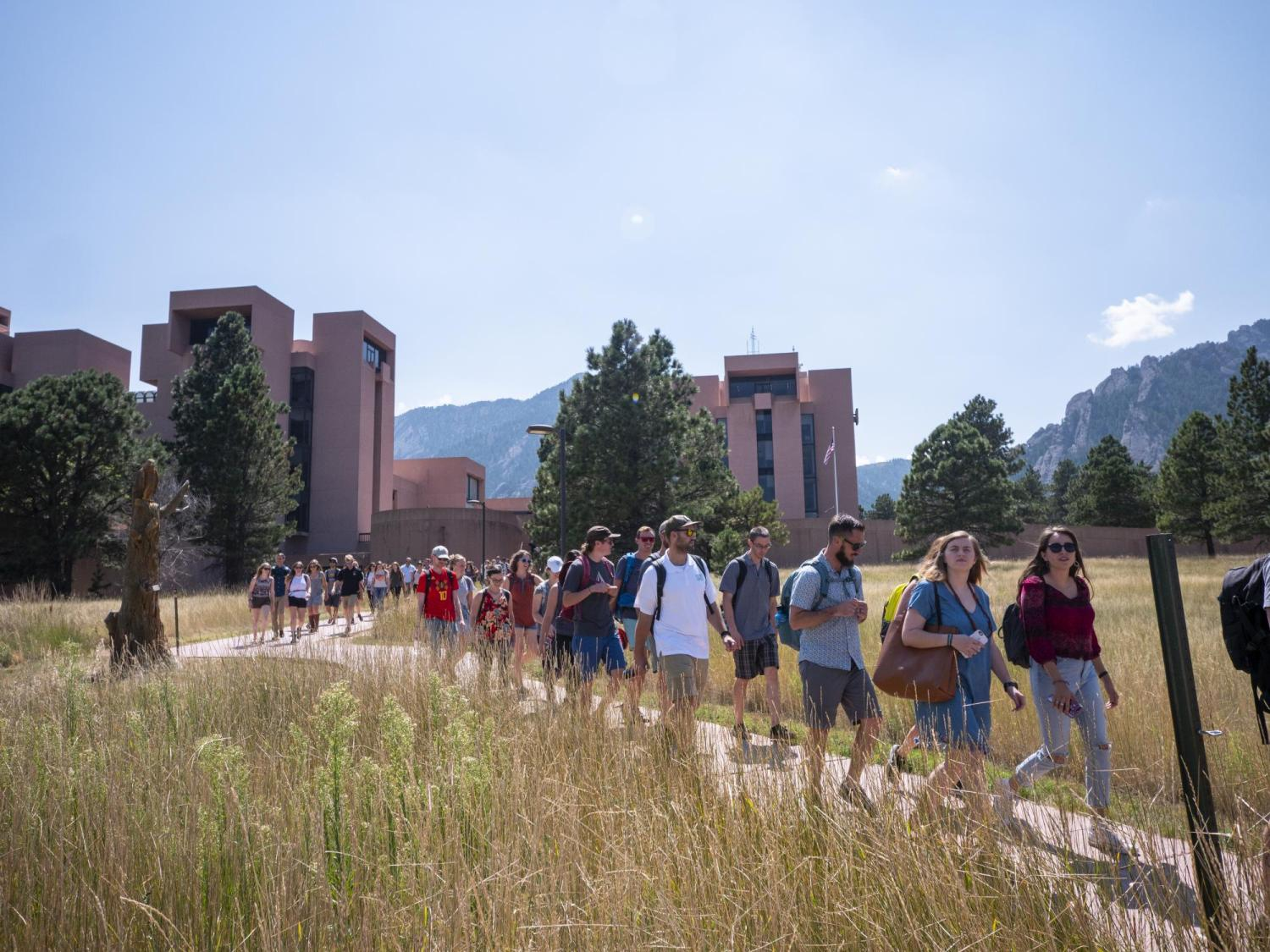 Students walking in front of NCAR