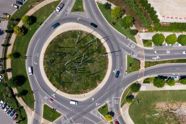 Drivers driving around roundabout.