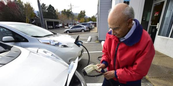 Saul Basri charges his electric car at Boulder Nissan on Oct. 23. Boulder County commissioners on Tuesday pledged to the eventual electrification of the county's entire vehicle fleet. (Paul Aiken / Staff Photographer)
