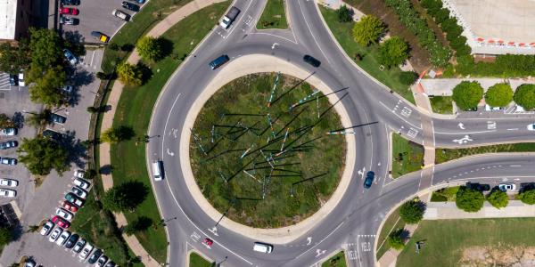 Drivers driving in a roundabout.