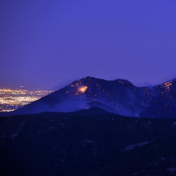 Fire smolders on Bear peak