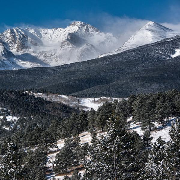 Winter view of the Continental Divide with the Mountain Research Station located in the forest below