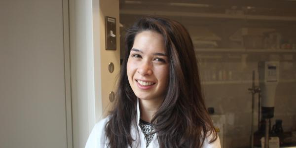 Elizabeth Hjelvik wearing white lab coat