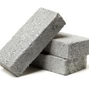 Stacked grey cement bricks