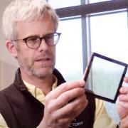 Mike McGehee looking at smart window prototype