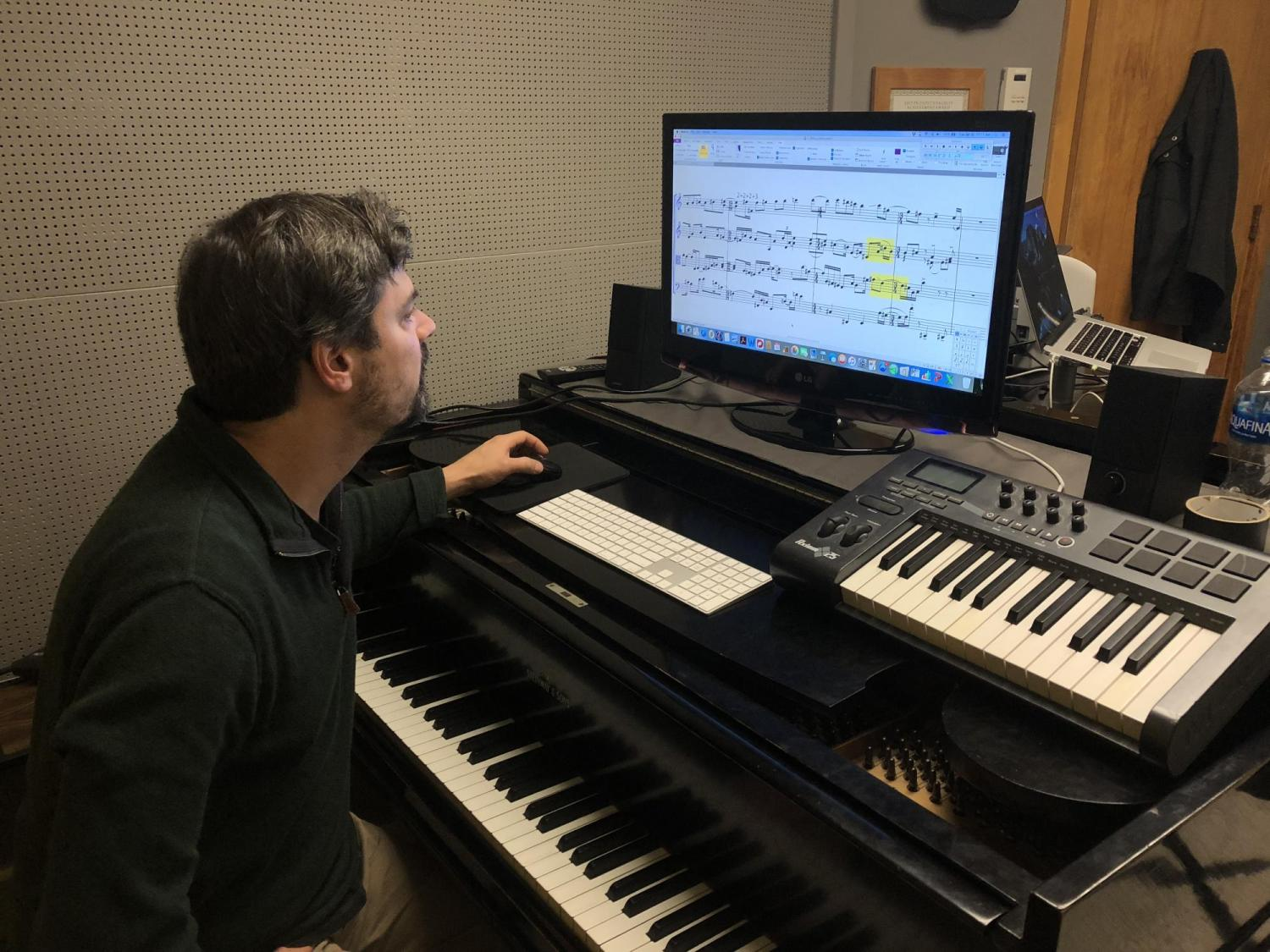Associate Professor of Composition Carter Pann works on the new equipment in his office, purchased with help from the new Christoffersen Faculty Fellowship in Composition.