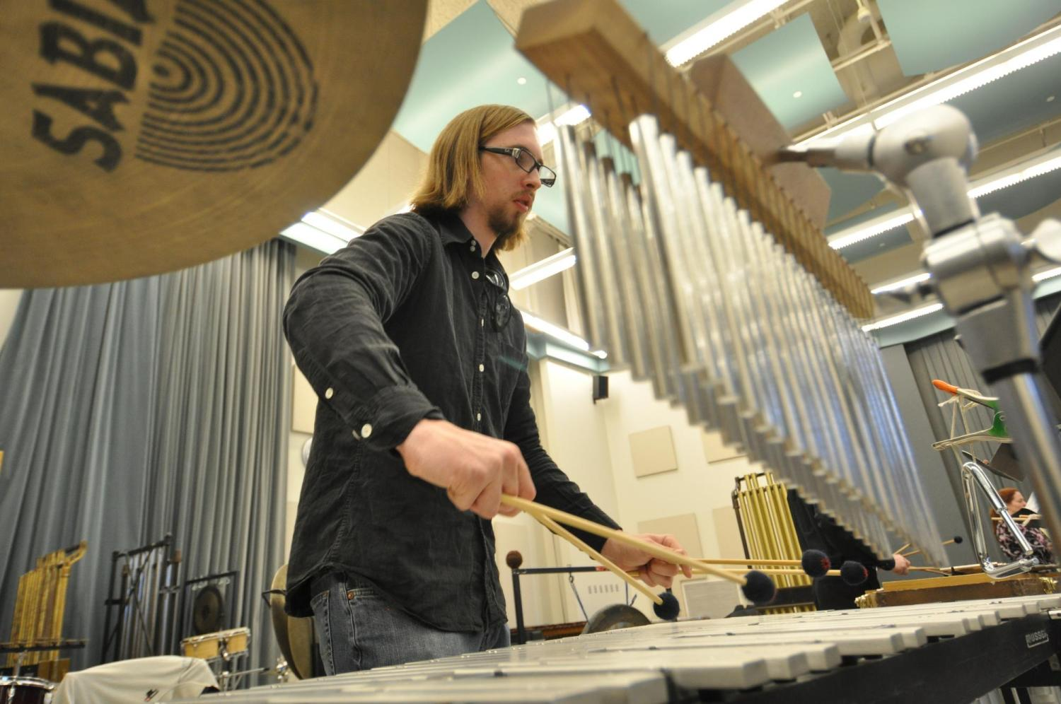 A student using four mallets on the vibraphone