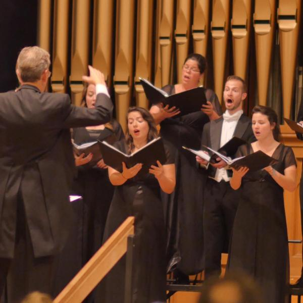 A CU Choir performing on stage