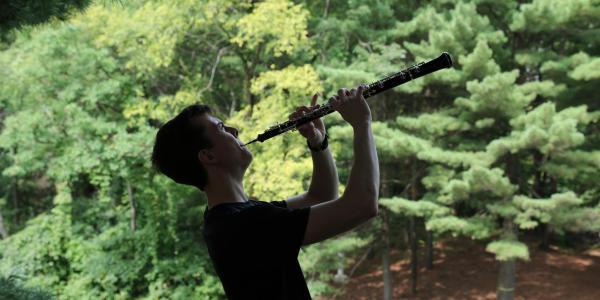 Curtis playing oboe