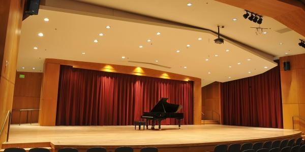 grusin music hall with a piano on stage