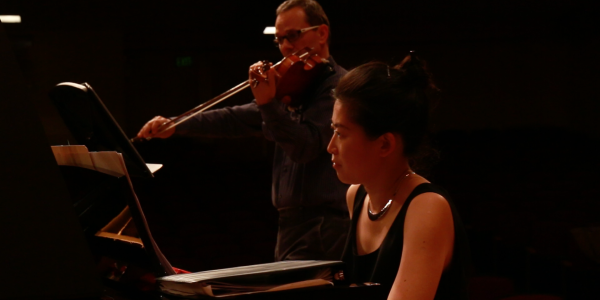 Charles Wetherbee and Hsing-ay Hsu rehearsing a Daniel Kellogg piece