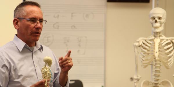 Professor teaching musical education