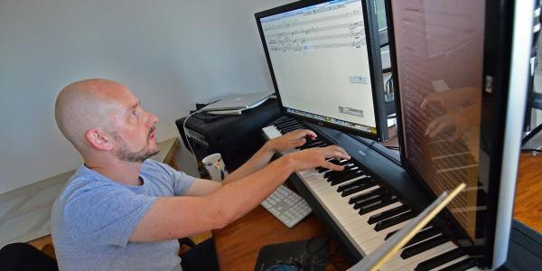 Composition teacher working on the computer