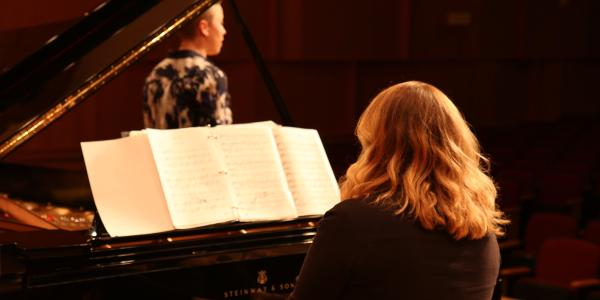 Student and Pianist on stage