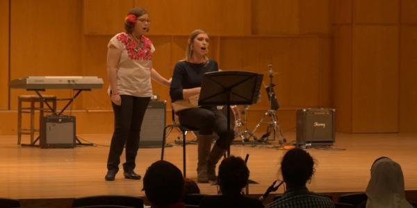 Musicology graduate students on stage performing