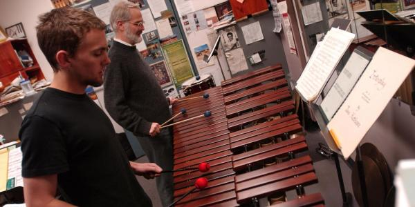 percussion student practices with teacher