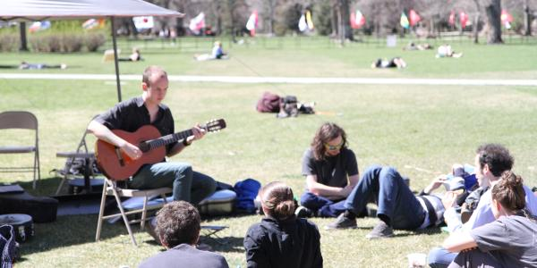 guitar student performing on norlin quad