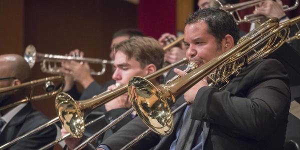student plays trombone in concert