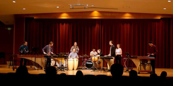 Percussion students on stage at Grusin Hall