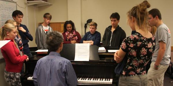 theory students gathered at piano