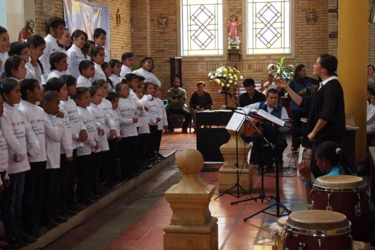 corie brown working with choral students in colombia