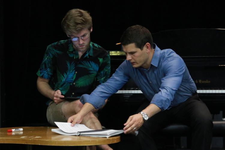 pianists look over music
