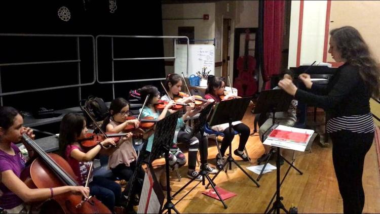 students rehearsing at el sistema