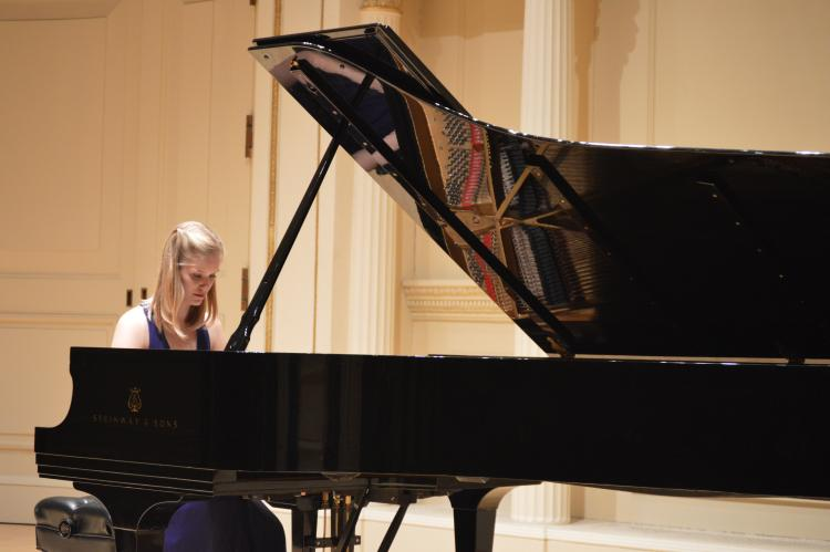 grace burns on stage at carnegie