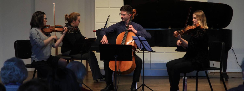 students performing at a church