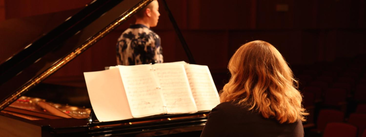 pianist on stage with singer