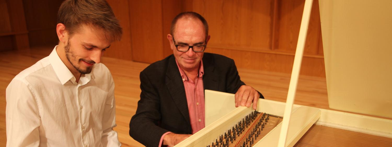 harpsichord professor with student