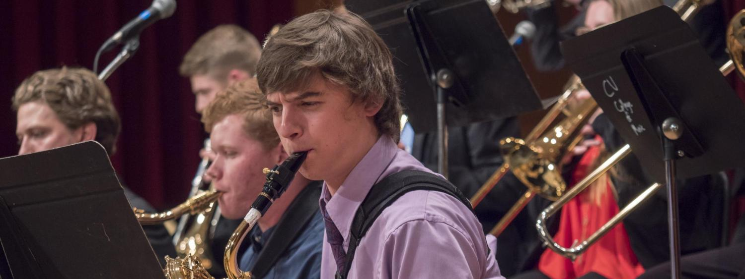 Student playing sax in Jazz band