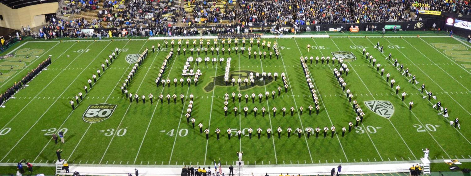 CU Golden Buffaloes marching band on the field during a CU football game