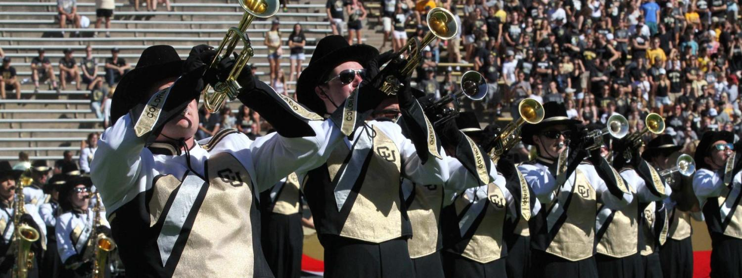 CU Golden Buffaloes marching band trumpet section celebrating CU.