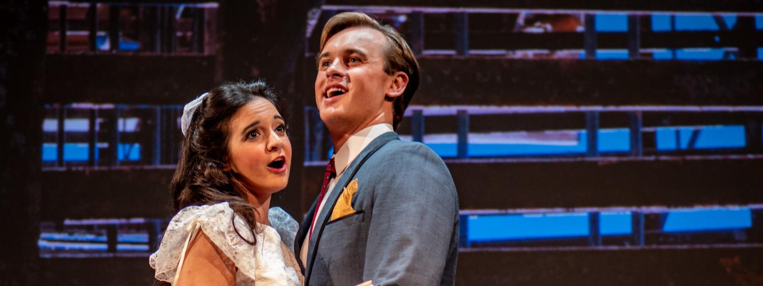 students on stage in west side story