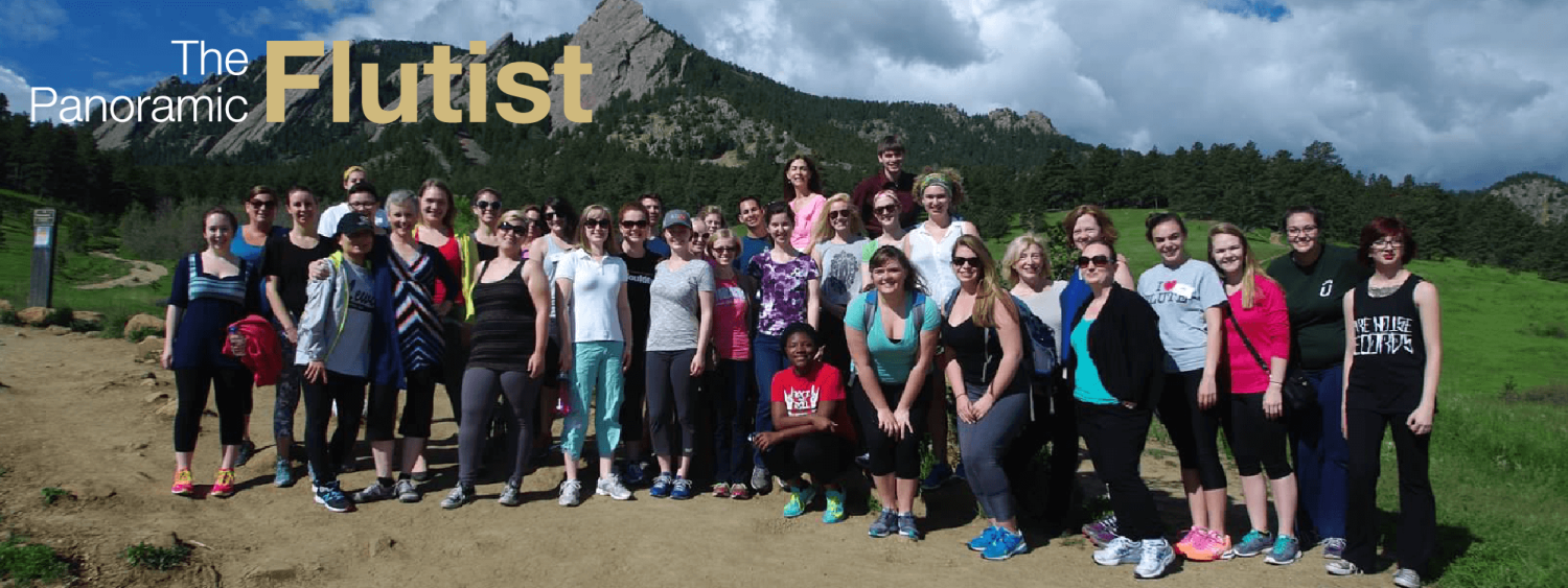 panoramic flutist image with students in front of mountains