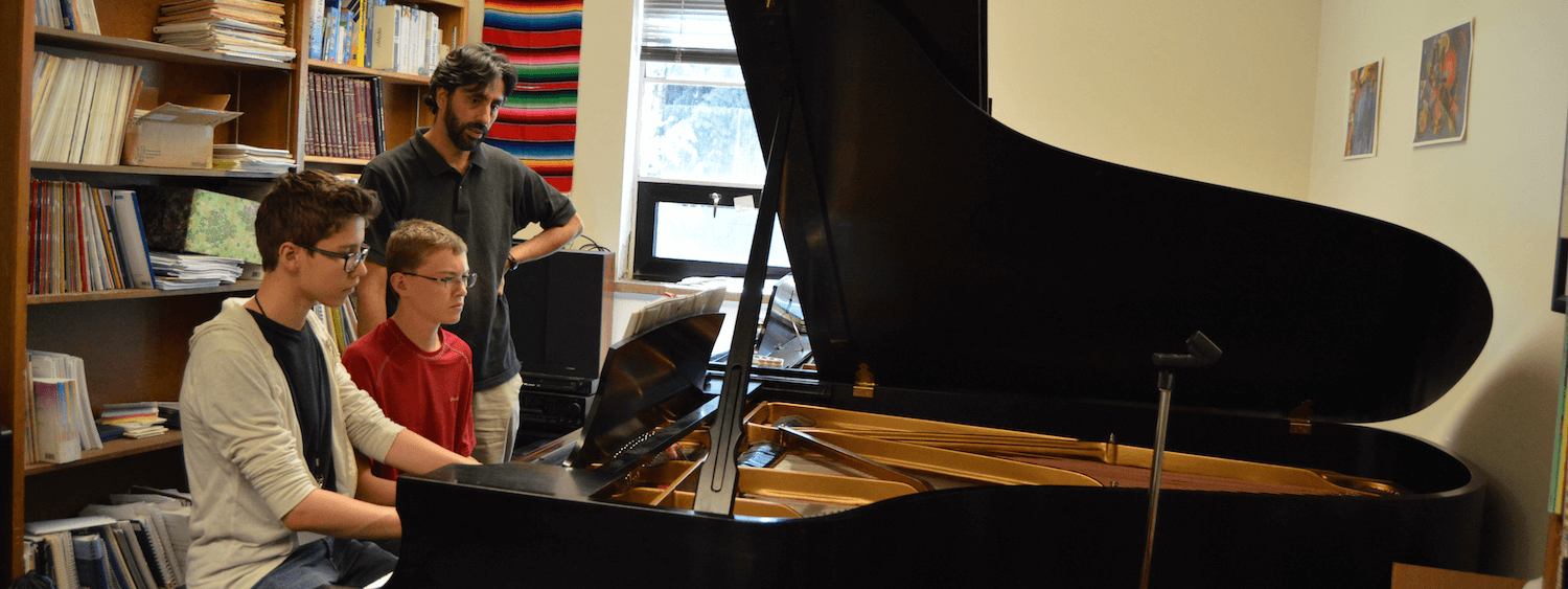 piano students and teacher
