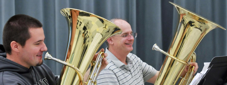 People playing the Tuba