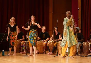 african ensemble on stage
