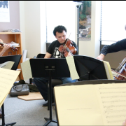 faculty members practicing a Finnish piece