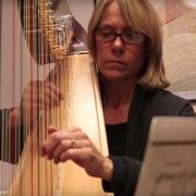janet harriman playing harp