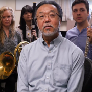yoshi and a group of students sitting in his office