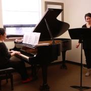 Hsing-ay-Hsu rehearsing with Abigail Nims