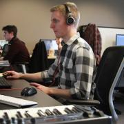 grad working at desk