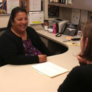 victoria ibarra works with a student