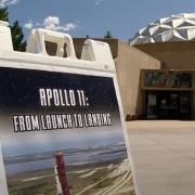 Fiske Planetarium with Apollo 11 poster in foreground
